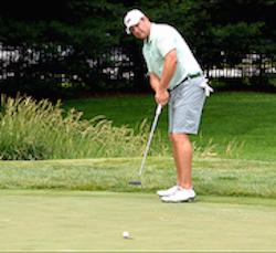 Jeff Osberg drains birdie on par-5 no. 5  <br>Courtesy of GAP