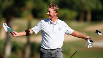 Schmitz reacts to his hole-in-one on the 33rd hole<br>USGA photo