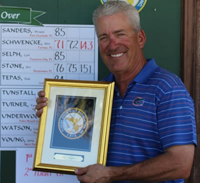 65-plus winner Kim Schwencke<br>- he aced the 8th hole on Monday
