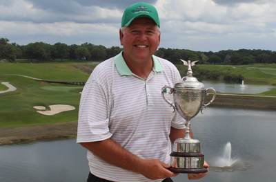 Peter Wegmann stands with trophy <br>(Florida State Golf Association Photo)</br>