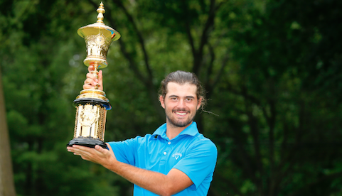 Curtis Luck holds the Havemeyer Trophy <br>(USGA Photo)
