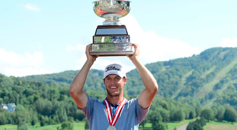 Garrett Rank hoists Canadian Mid-Amateur trophy <br>(Charles Laberge/ Golf Canada Photo)