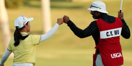 Chia Yen Wu celebrates with her caddie <br>after extending the match with a long birdie on the 26th hole (USGA)