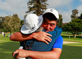 Doug Ghim hugs his mother after winning his match against Connor Syme