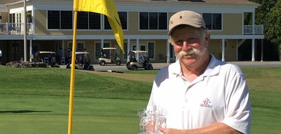 Mark Plummer holds the Maine Senior trophy for the 5th time<br>(Maine State Golf Association photo)