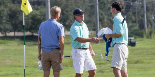 Danny Nelson (center) shakes hands with runner-up John Skeades III as 2016<br>champion Tripp Coggins looks on (Ben Brengman/Savannah Morning News)