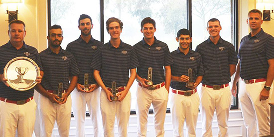 The Saint Mary's men's golf team accepting the trophy as the rain fell outside<br>(St. Mary's photo)
