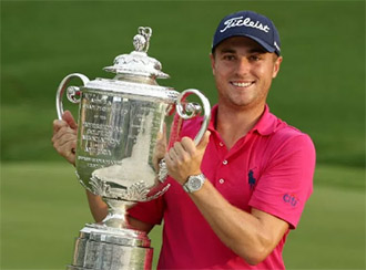 Justin thomas with the PGA Championship trophy