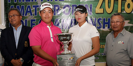 Tom Kim and Hwang Min-jeong (center) got their hands on the trophy in different ways<br>(National Golf Association of the Philippines photo)