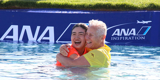 Rose Zhang (L) leaped into Poppie's Pond with World Golf Hall of Famer Patty Sheehan<br>(AJGA photo)