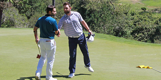Matt Cohn (L) is congratulated by Bobby Bucey after his playoff win (NCGA photo)