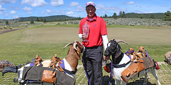 Darren Kuhn with Silvies Valley Ranch goat caddies (PNGA photo)