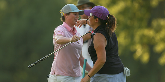 Kelsey Chugg (left) hugs Julia Potter-Bobb (USGA photo)