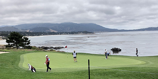 Players and caddies on No. 8 green during the U.S. Amateur at Pebble Beach (AGC photo)