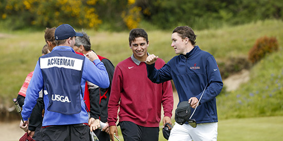 Derek Ackerman, in red, with partner Matthew McCarty, right (USGA/Steve Gibbons)