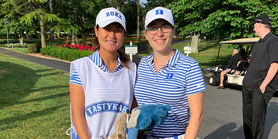 Gina Kim caddied for her Duke teammate Virginia Elena Carta (Duke Athletics photo)