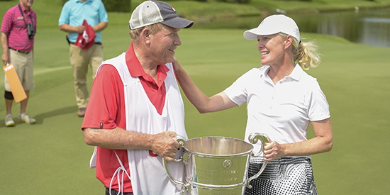 Defending champion Lara Tennant with dad/caddie George Mack Sr (USGA photo)