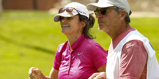 Sue Wooster with her husband and caddie (USGA/Steve Gibbons)