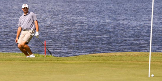 Ty Gingerich watching his eagle attempt at the par-5 9th<br>(Will Brown/St. Augustine Record photo)
