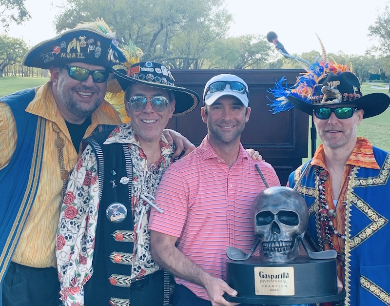 Spared by pirates - Derek Busby poses with some salty dogs and his Gasparilla trophy